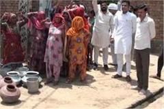 people drinking water getting contaminated water supply