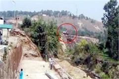 dirt of dumping site thrown in ravine
