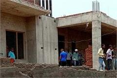 2 killed in wall collapse