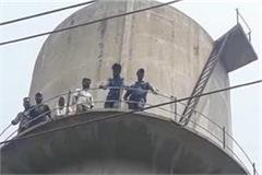 many families climbing on water tank