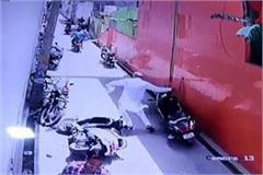 man pushed two wheelers in street for not got space cctv recorded