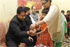 collector tied rakhi with visually impaired girl students