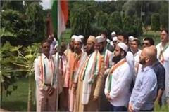 sp patron mulayam singh yadav hoisted the tricolor at the party headquarters