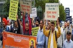 demonstration in german to break the sri guru ravidas temple in delhi