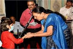 anandiben adopts a girl with tb disease