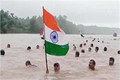 unique spirit patriotism people swim 11 km swollen narmada river