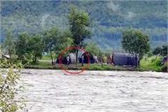 labourer stranded in river