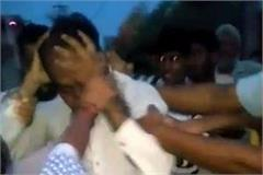 teacher tied to a pole and beaten
