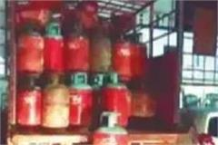 truck loaded with cylinders