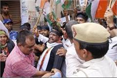 opposition of cm congress leader and activist arrested in dadri