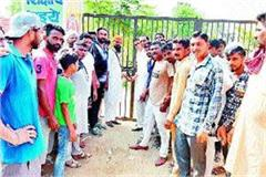 villagers of haripura set the school locked