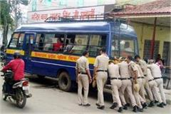 police personnel push the police bus