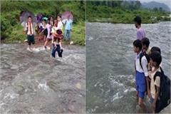 student crossing the ravine