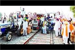 farmers  anger continues raising tractor on railway tracks