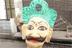 up people will burn corona with ravana picture of virus shown on effigy