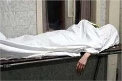 dead body of a person thrown in an empty plot