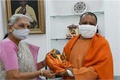 cm yogi congratulates anandiben patel on her 79th birthday