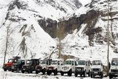 light snowfall on the peaks including rohtang and baralacha