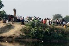 after accident bike rider fell in yamuna along with wife and child