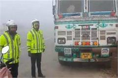 fog havoc car and bike entered into a trunk standing on the national highway