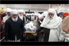 a crowd of companions gathered for the last visit of sant baba ram singh