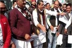 rld workers burn copies of agricultural land documents on farmer s day