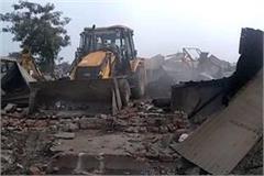 bulldozer over illegal encroachment demolished more than two dozen buildings
