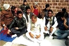 legislators sitting on dharna against their government