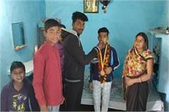 son of hair cutter becomes gold medalist