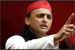 akhilesh taunts bjp ayushman plans joke