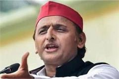 akhilesh says a wall erected to hide the huts from the trump