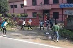 video of two groups of students clashing on the road viral