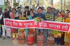 people on the road protest against cylinder raising prices lpg