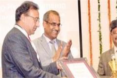 isro awarded  best coordinator award  to dr jagdish