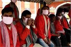 corona awe in kanpur  masks distributed to porters and security