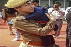 female policeman who came to duty with 18 month old child
