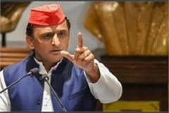 akhilesh said government neglecting workers trapped in other states