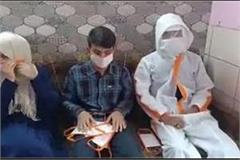 amu students made doctors  ppe kit and mask while sitting at