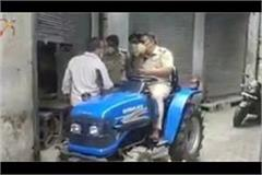 city police conducted search operation in the streets riding on a mini tractor