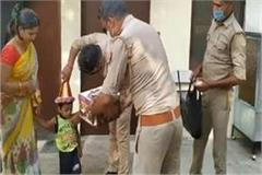 up banda police delivering cake on the birthday of the child