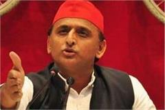akhilesh yadav s verbal attack  taking money from workers brought