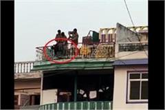 a young man coming from poona tried to hang himself publicly on the roof