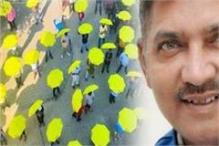 unique initiative taught social distancing lesson by sharing the umbrella