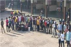 for the last 4 days migrant laborers sitting at bus station