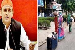 akhilesh yadav wins heart gives 1 lakh help to child sleeping on trolley bag