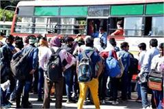 more than 70 passengers being seated in buses social distancing in public