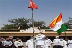 mla raminder awla hoisted the national flag on labor day