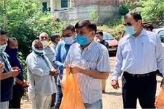 mla rana is distributing mask and sanitizer in sujanpur panchayats