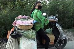 sunita selling the vegetable on scooty