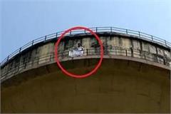 veeru becomes young man for fee waiver demonstrating by climbing on water tank